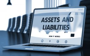 Assets And Liabilities Concept on Laptop Screen.